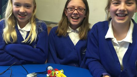 Three pupils, one alligator. Charlie Manning, Isabelle Whatling and Grace Beckett at Claydon Primary