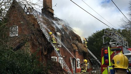 As well as dowsing the flames, firefighters are removing the thatch Picture: MARIAM GHAEMI