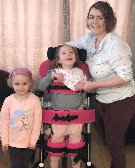 From left: Tracey Bayliss, five, Teigan Bayliss, seven, and their mum Rebecca Bayliss Picture: TONY