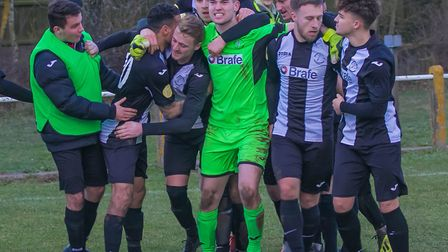 Woodbridge Town players celebrate Jake Rudge's late leveller against Stowmarket Town. Picture: PAUL