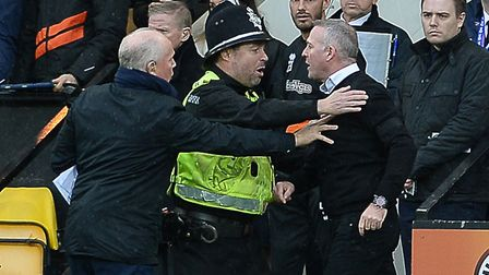 Paul Lambert is held back as tempers flare up just before half-time at Carrow Road Picture Pagepix