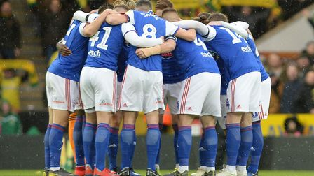 Ipswich Town players huddle before the derby day defeat at Norwich. Picture: PAGEPIX LTD