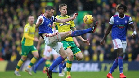 Norwich City's Marco Stiepermann (right) battles for the ball against Ipswich Town's Cole Skuse (lef