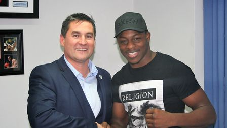 Darren Hyde managing director of VIP Security Services, with boxer Dan Azeez who has had six profess