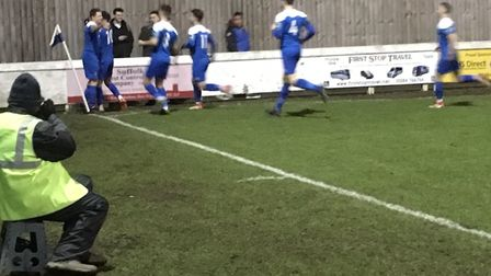 Bury Town players celebrate Cemal Ramadan's second minute opening goal, near the corner flag. Pictur