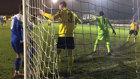 Witham Town, under the cosh, are set to defend another corner with Kevin Coyle (No.3) on the goal-li