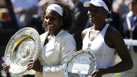 Sisters Serena and Venus Williams are legends of tennis. Picture: PA SPORT