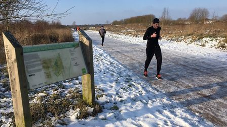 Runners make their way along the icy route at Ellenbrook Fields, during last Saturday's parkrun, whi