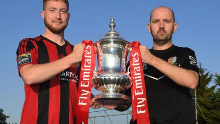 Brighlingsea Regent manager Tom Rothery, right, with captain Matt Cripps, holding the FA Cup ahead o