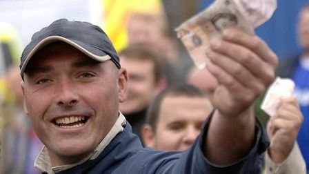 Ipswich Towns fans flash the cash on the way to Carrow Road ahead of Marcus Evans' takeover. Photo: