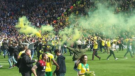 Fans flood onto Carrow Road after Norwich City had beaten Ipswich Town in the second leg of the Cham
