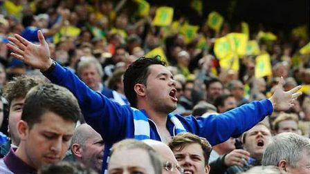 Ipswich Town fans cheer on their side at Carrow Road in 2015. Photo: Archant