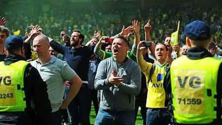Norwich City fans goad Ipswich Town supporters following play-off victory in 2015. Photo: Archant