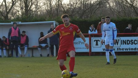 New signing for Needham, Russell Short on the ball for the Marketmen Photo: BEN POOLEY