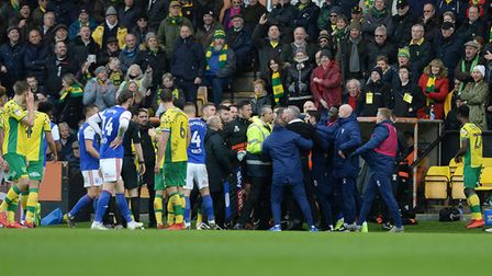 Members of the two benches get involved in a fracas just before half-time at Norwich Picture Pagepix