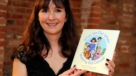 """Katherine Simpson-Jacobs with her book """"What We Did When Mummy Got Cancer"""" at the launch of the book"""