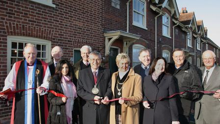Trustees and supporters of the Winsley's Almshouses project cut the ribbon at the Colchester site Pi