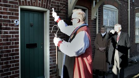 The Bishop of Colchester blessing the refurbished almshouses Picture: NIGEL BROWN