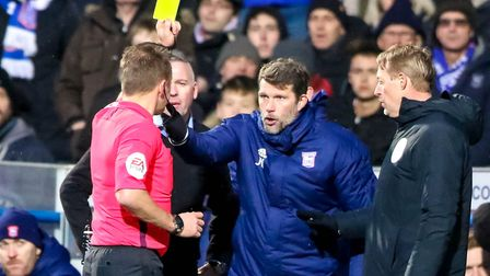 Ipswich Town goalkeeping coach Jimmy Walker picked up a yellow card from referee Oliver Langford fol