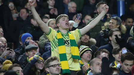 The traveling Norwich City fans celebrate their side's 3-1 victory at Leeds United last weekend. Pho