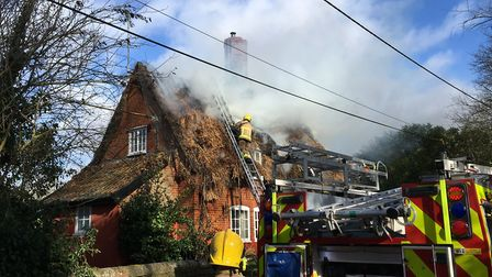 The scene in High Rougham, not far from Blackthorpe Barns, as firefighters tackle a blaze in a thatc