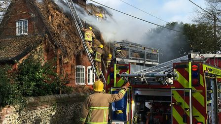 Dozens of firefighters are battling a blaze in a thatched roof in Rougham Picture: ARCHANT
