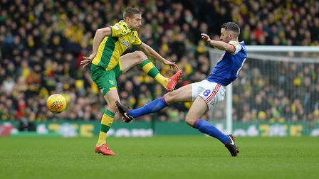 Cole Skuse flying into a challenge on Marco Stiepermann Picture Pagepix