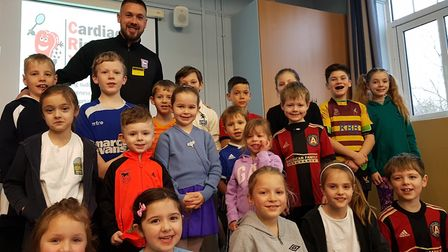 Ipswich Town Captain Luke Chambers speaking to children at Witnesham Primary School about healthy ea