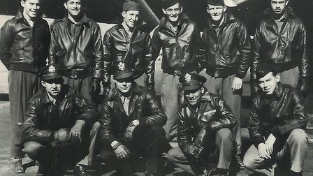 """The crew of B-17 Flying Fortress nicknamed """"Mi Amigo"""" of the 305th Bomb Group. Back Row: Robert Mayf"""