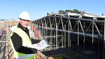Craig Hannatt from Carlton Fun Factory looks over the play centre's site after the storm damage. Pic