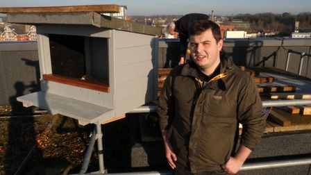 Conservation student Jamie Everett (foreground) who helped Peter Merchant (behind) build a nest box