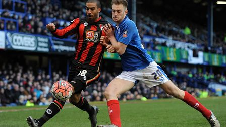 Portsmouth's Matthew Clarke (right) has been linked to Stoke. Photo: PA