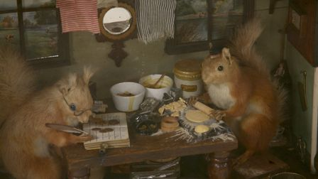 the Royal Acorn Dairy, a detailed diorama populated by two squirrels preparing food at the kitchen t