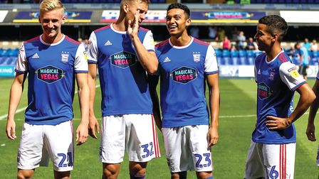 Town's young midfield trio Flynn Downes, Andre Dozzell, Tristan Nydam pictured with Luke Woolfenden
