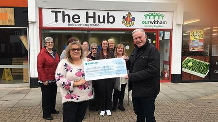 Cllr Ramage hands over a cheque to Tina Townsend, chair of Witham Chamber of Commerce
