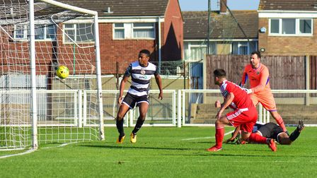 Jack Ainsley (in red) opens the scoring for Felixstowe at Tilbury back in October Photo: THOMAS BRAD