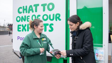 Wendy Marchant of Macmillan Cancer Support gives information to a member of the public.