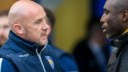 U's boss John McGreal and Macclesfield manager Sol Campbell. Picture: STEVE WALLER
