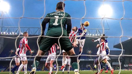 Will Keane heads the ball in a late equaliser for Ipswich Town in the 1-1 draw against Stoke City.