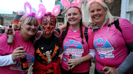 The 10th Girls Night Out walk for St Nicholas Hospice Care gathering on the Angel Hill in Bury St Ed