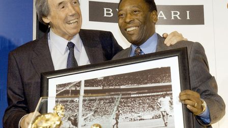 Gordon Banks (left) with a picture of his famous save from Brazil striker Pele (right). Photo: PA