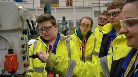 Work experience students with apprentice Beth Gant in the maintenance workshop at the power station