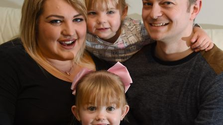 Craig Palmer with wife Sammie, and daughters, Lily-Mae, three, and Mia-Rose, two Picture: DENISE BRA