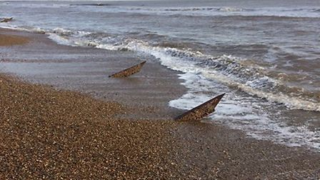 Mr Finch was walking along the beach when he saw the objects peaking out of the sand Picture: NORMAN
