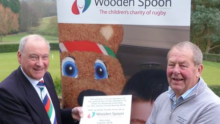 Alan Line (right) presented a cheque to Norman Davidson of Wooden Spoon for £4266 raised during his