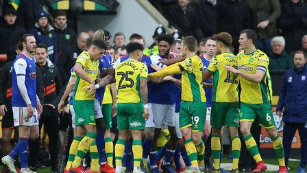 Norwich City's and Ipswich Town's players confront each other before half time during the Premier Le