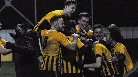 Stowmarket Town players celebrate George Quantrell's 89th minute winner against Brantham Athletic. P