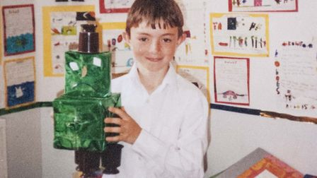 Tom Brittain, aged 11, with the robot he created to win a Blue Peter badge Picture: SUPPLIED BY FAMI