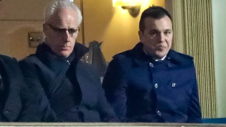 Former Town manager Mick McCarthy sitting next to a concerned looking Lee O'Neil, during the Ipswich