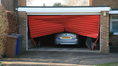 The garage doors at the house in Fornham All Saint were badly damaged by the collision Picture: ARCH